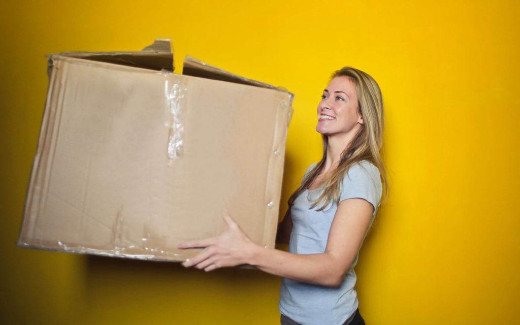 Woman holding storage box